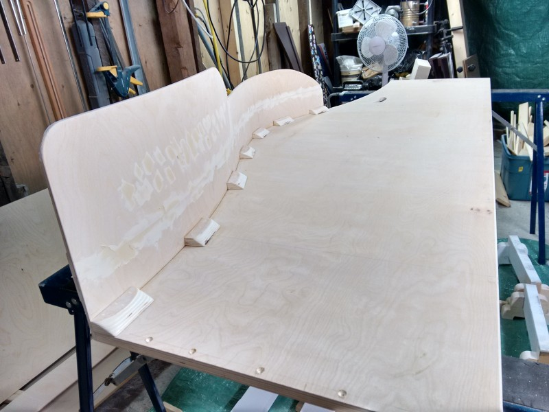 Layering and gluing up the curved safety rail.